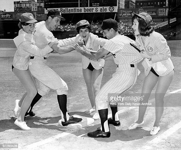 "Jerry Coleman and Phil Rizzuto are ""separated"" by umpires Carolyn Larson, Elsie Lindauer and Holly Hill at Yankee Stadium.The umps intervened when..."