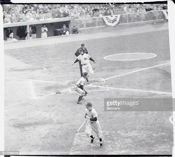 Jerry Coleman scores the first run as Gil McDougald flies out to center field in the first inning of the sixth Giants vs Yankees World Series game...