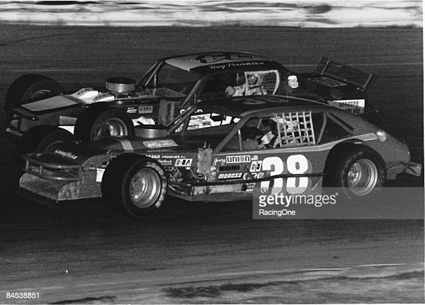 Jerry Cook driver of the Ford Pinto modified races with fellow legend Roger Treichler on a short track during the NASCAR Modified series circa 1970's