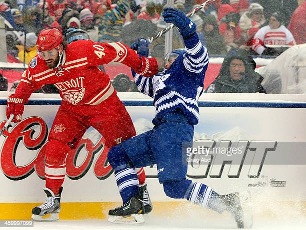 Jerry D'Amigo of the Toronto Maple Leafs runs into Henrik Zetterberg of the Detroit Red Wings during the 2014 Bridgestone NHL Winter Classic January...
