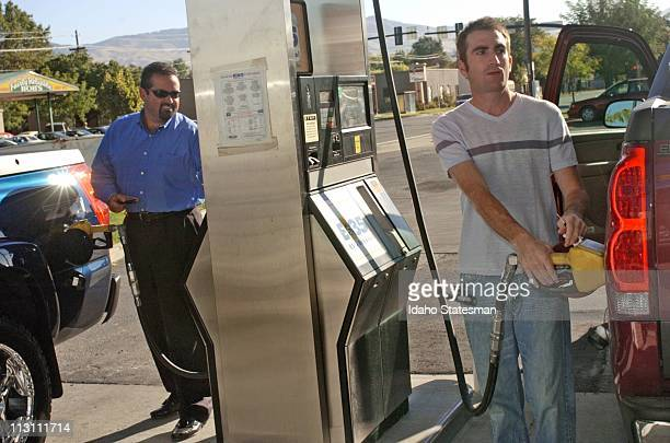Jerry Doyle left and David Marmillion fill their Chevy Avalanche vehicles with E85 ethanol fuel September 14 2005 in Boise Idaho In addition to the...