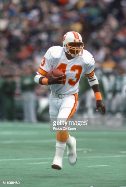 Jerry Eckwood of the Tampa Bay Buccaneers carries the ball against the Philadelphia Eagles during an NFL football game October 25 1981 at Veterans...