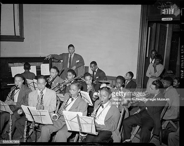 Jerry Elliott's band first row from left Gene Elliott Hosea Taylor Stewart 'Stew' Strothers and Joe Henderson on saxophones Ahmad Jamal on piano...
