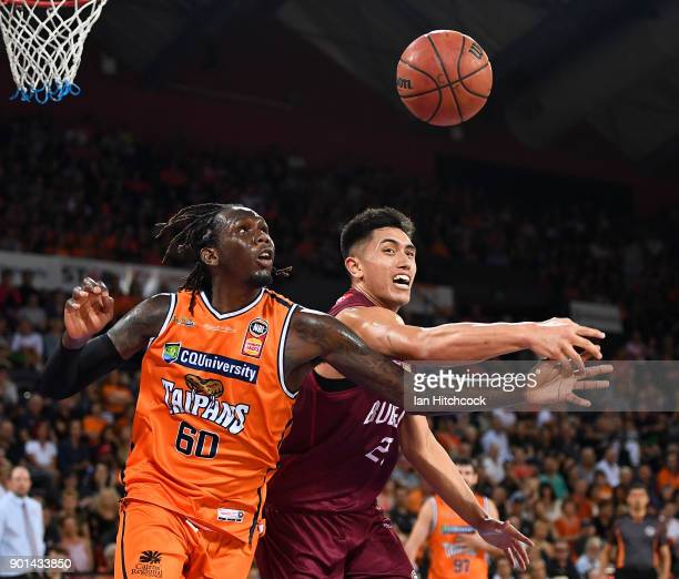 Jerry Evans Jr of the Taipans and Reuben Terangi of the Bullets contest the ball during the round 13 NBL match between the Cairns Taipans and the...