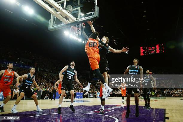 Jerry Evans Jr of the Taipans dunks on Finn Delany of the Breakers during the round 13 NBL match between the New Zealand Breakers and the Cairns...