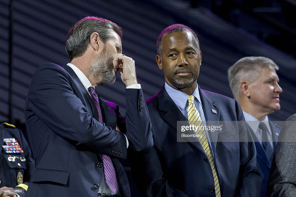 Jerry Falwell Jr., president of Liberty University, left, talks to Ben Carson, 2016 Republican presidential candidate, during a Liberty University Convocation in Lynchburg, Virginia, U.S., on Wednesday, Nov. 11, 2015. As retired neurosurgeon Carson has risen in the polls, media reports have revisited his accounts of acts of violence as a child, a key part of the redemption story he discusses on the campaign trail. Photographer: Andrew Harrer/Bloomberg via Getty Images