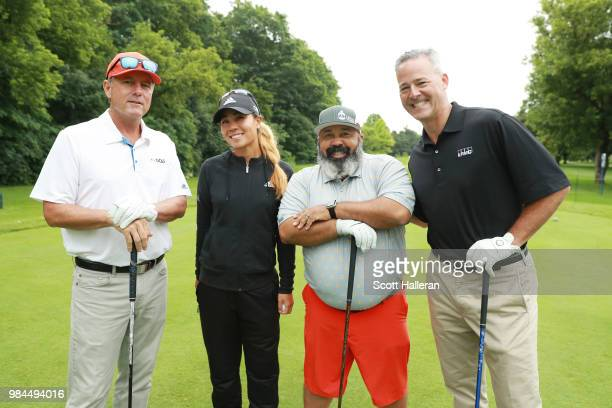 Jerry Foltz, Danielle Kang, Michael Collins and Chris Goodman pose together on the first tee during the pro-am prior to the start of the KPMG Women's...