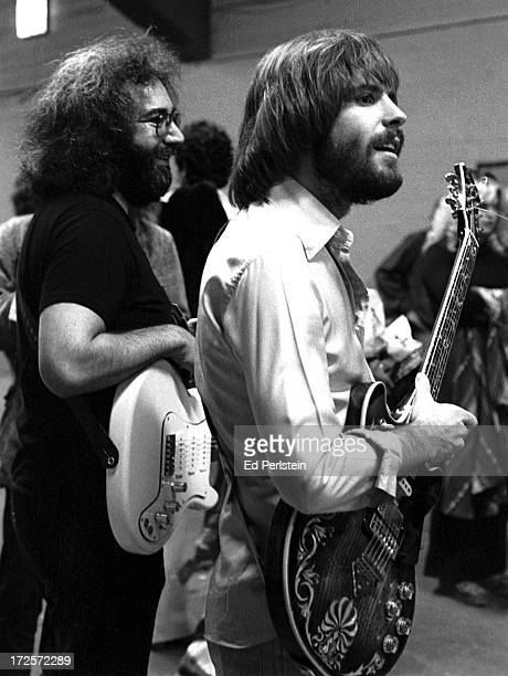 Jerry Garcia and Bob Weir of The Grateful Dead pose backstage at the Cow Palace on New Years Eve 1976 in San Francisco California
