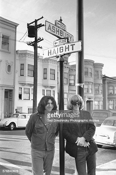 Jerry Garcia and Phil Lesh of the Grateful Dead stand at the corner of Haight and Ashbury in San Francisco