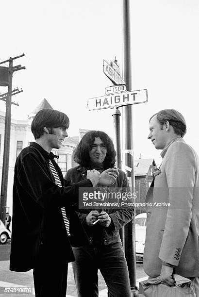 Jerry Garcia and Rock Scully manager of the rock band the Grateful Dead speak to author Tom Wolfe at the corner of Haight and Ashbury