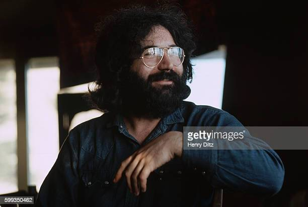 Jerry Garcia in his younger years sits to discuss and play guitar for an album with musician David Crosby during the early 1970s