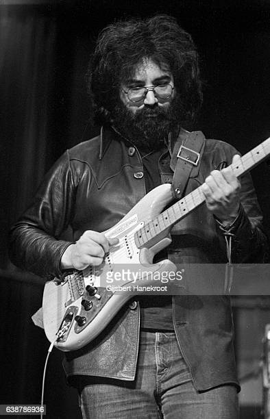 Jerry Garcia of The Grateful Dead performs on stage at the Tivoli Concert Hall in April 1972 in Copenhagen Denmark He plays a Fender Stratocaster...