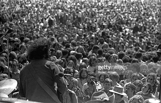Jerry Garcia of The Grateful Dead plays live in front of a large Polo Field crowd on May 7 1969 at Golden Gate Park in San Francisco California