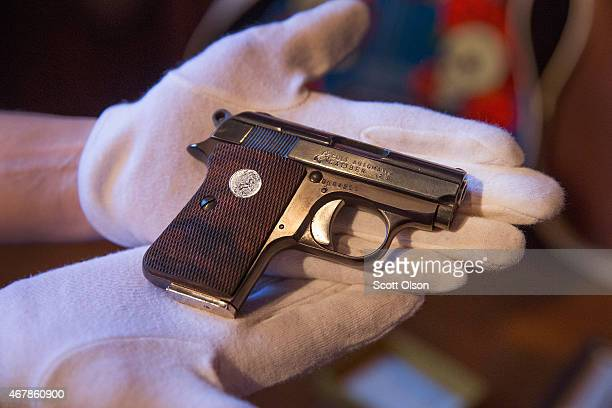 Jerry Garcias Colt 25 automatic pistol is prepared for auction on March 27 2015 in Union Illinois A huge collection of Grateful Dead memorabilia will...