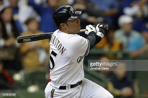Jerry Hairston Jr #15 of the Milwaukee Brewers hits a sacrifice fly ball scoring Ryan Braun in the fourth inning of Game One of the National League...