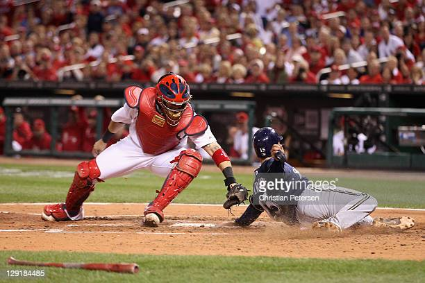 Jerry Hairston Jr. #15 of the Milwaukee Brewers slides safely into home plate as he scores on a RBI single by Yuniesky Betancourt in the top of the...