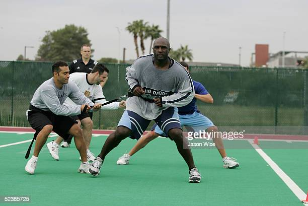Jerry Hairston of the Baltimore Orioles holds a resistant cord while Calvin Pickering of the Kansas City Royals performs a resisted shuffles drill...