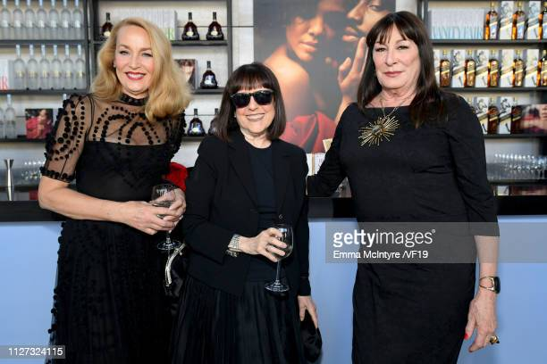 Jerry Hall and Anjelica Huston attend the 2019 Vanity Fair Oscar Party hosted by Radhika Jones at Wallis Annenberg Center for the Performing Arts on...