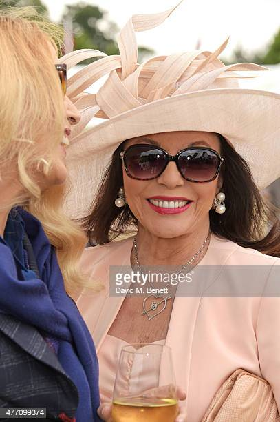 Jerry Hall and Dame Joan Collins attend The Cartier Queen's Cup final at Guards Polo Club on June 14 2015 in Egham England