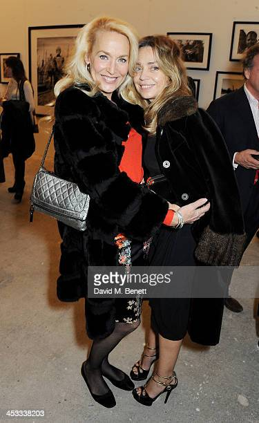 Jerry Hall and Jeanne Marine attend a private view of Nikolai Von Bismarck's new photography exhibition 'In Ethiopia' at 12 Francis Street Gallery on...