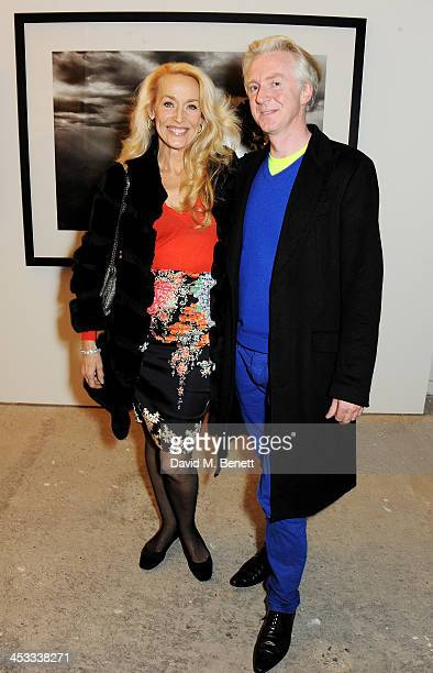 Jerry Hall and Philip Treacy attend a private view of Nikolai Von Bismarck's new photography exhibition 'In Ethiopia' at 12 Francis Street Gallery on...