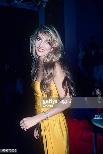 Jerry Hall in a yellow strapless dress circa 1978 New York
