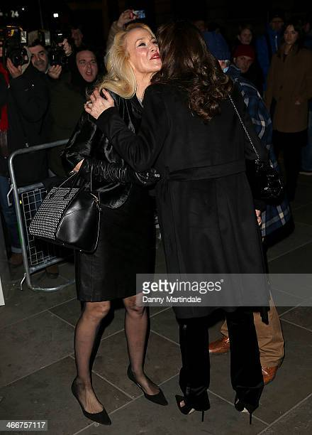 Jerry Hall kisses Catherine Bailey as they meet outside the VIP private view of David Bailey Bailey's Stardust at National Portrait Gallery on...