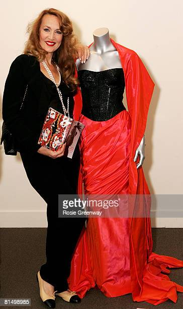 Jerry Hall poses with an Edina Ronay skirt and stole at a photocall prior to an auction of several of her vintage dresses including the wedding dress...