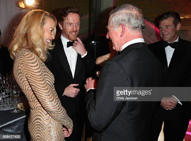 Jerry Hall, Prince Charles, Prince of Wales and Damien Lewis chat as they attend a pre-dinner reception for the Prince's Trust Invest in Futures Gala...