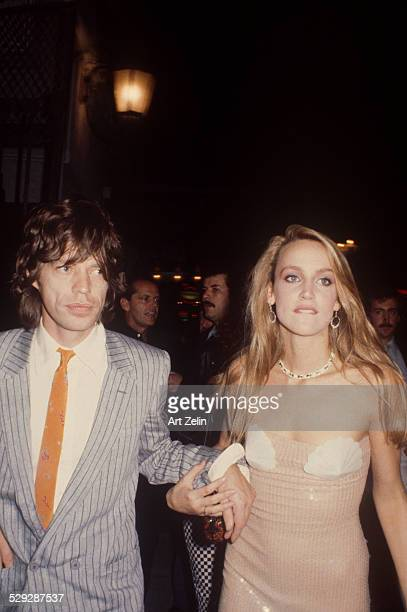 Jerry Hall with Mick Jagger going to a formal event; circa 1980; New York.