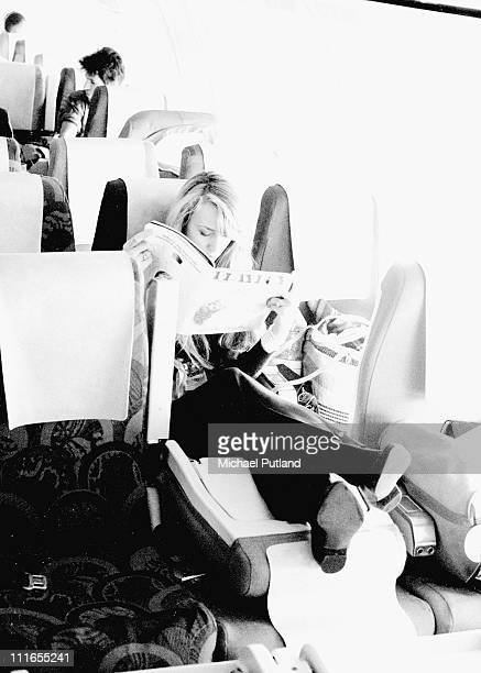 Jerry Hall with The Rolling Stones on tour on a plane 1982