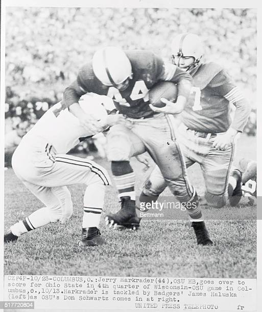 Jerry Harkrader of Ohio State scores a touchdown in the fourth quarter of the October 23rd game with Wisconsin He is tackled by the Badger's James...