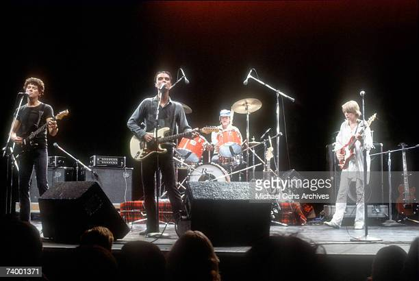 Jerry Harrison David Byrne Chris Frantz and Tina Weymouth of art rock group The Talking Heads perform onstage in circa 1980 Los Angeles California