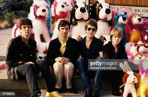 Jerry Harrison David Byrne Chris Frantz and Tina Weymouth of the Talking Heads pose for a portrait in front of stuffed animals in December 1977 in...