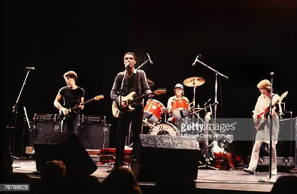 Jerry Harrison David Byrne Chris Frantz and Tina Weymouth of the Talking Heads perform at a concert circa the early1980s in Hollywood California