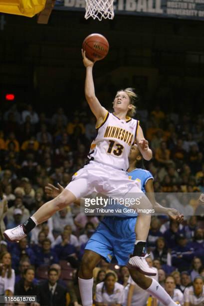 Jerry Holt/Star Tribune 3/21/2004 First Round action Minnesota vs UCLAMinnesota star player Lindsay Whalen scores of UCLA Noelle Quinn the first half...