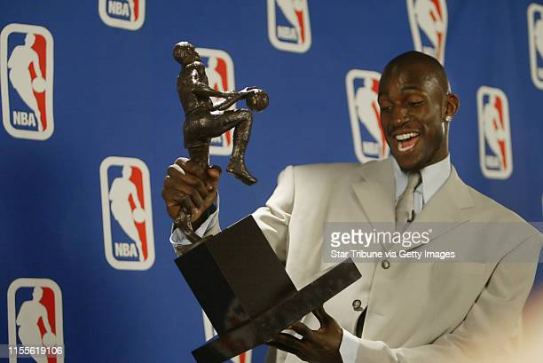 Jerry Holt/Star Tribune 5/3/2004----Minnesota Timberwolves forward Kevin Garnett just beams over the Maurice Podoloff Trophy after he was presented...