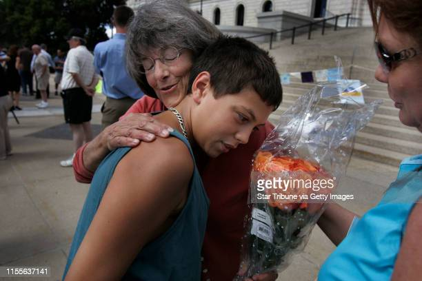 Jerry Holt/Star Tribune 8/21/2005State Senator Becky Lourey left received a hug and a dozen rose from 13yearold Amir Rose of Plymouth as his mom...