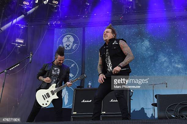 Jerry Horton and Jacoby Shaddix of Papa Roach perform on stage during the third day of 'Rock am Ring' at the Flugplatz Mendig on June 7 2015 in...