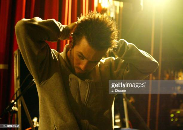 Jerry Horton of Papa Roach inserts his earplugs prior to his performance at the Warfield in San Francisco