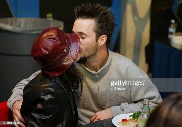 Jerry Horton of Papa Roach kisses his girlfriend prior to the band's performance the Warfield in San Francisco