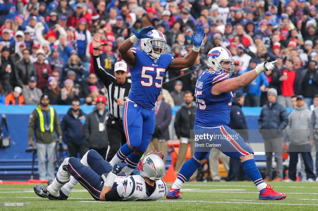 Jerry Hughes #55 of the Buffalo Bills and Kyle Williams #95 of the Buffalo Bills celebrate after Williams sacked Tom Brady #12 of the New England Patriots during the second quarter on December 3, 2017 at New Era Field in Orchard Park, New York.