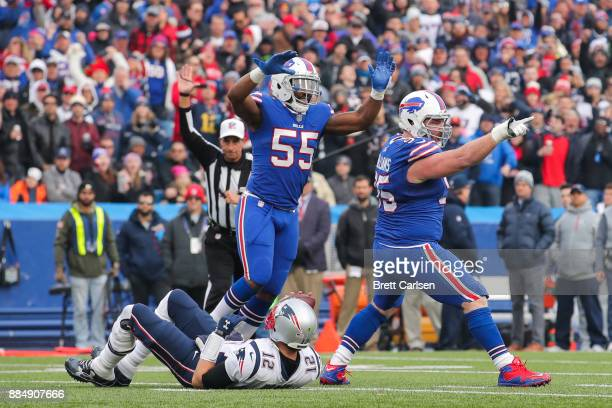 Jerry Hughes of the Buffalo Bills and Kyle Williams of the Buffalo Bills celebrate after Williams sacked Tom Brady of the New England Patriots during...