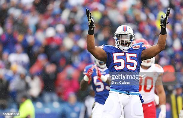 Jerry Hughes of the Buffalo Bills celebrates a tackle for a loss against the Kansas City Chiefs during the first half at Ralph Wilson Stadium on...