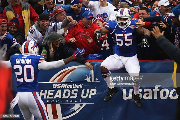 Jerry Hughes of the Buffalo Bills celebrates a touchdown against the Cleveland Browns during the second half at Ralph Wilson Stadium on November 30,...