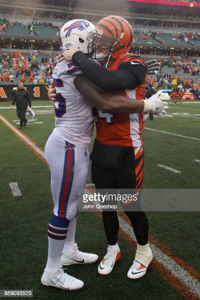 Jerry Hughes of the Buffalo Bills congratulates Andy Dalton of the Cincinnati Bengals at the end of the game at Paul Brown Stadium on October 8 2017...