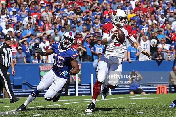 Jerry Hughes of the Buffalo Bills pressures Carson Palmer of the Arizona Cardinals during the first half at New Era Field on September 25 2016 in...