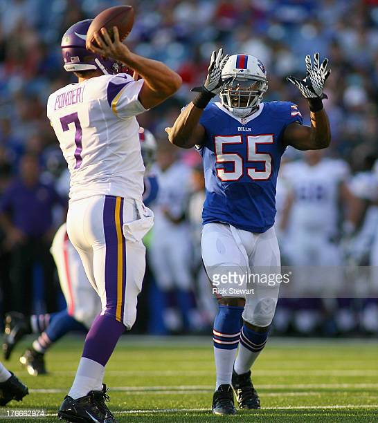 Jerry Hughes of the Buffalo Bills puts pressure on Christian Ponder of the Minnesota Vikings at Ralph Wilson Stadium on August 16 2013 in Orchard...