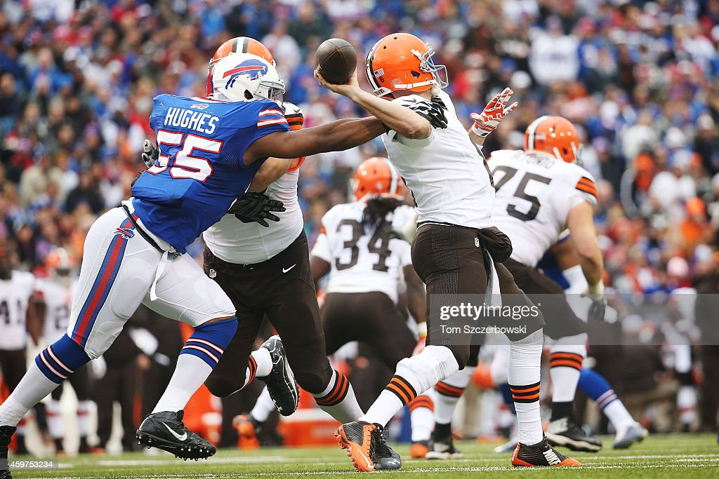 Jerry Hughes #55 of the Buffalo Bills reaches in on quarterback Brian Hoyer #6 of the Cleveland Browns during the first half at Ralph Wilson Stadium on November 30, 2014 in Orchard Park, New York.
