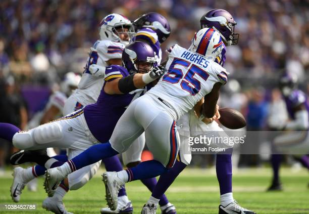 Jerry Hughes of the Buffalo Bills strips the ball out of the hands of Kirk Cousins of the Minnesota Vikings in the first quarter of the game at US...